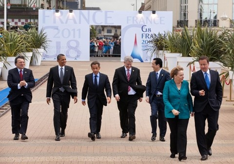 President Barack Obama and other world leaders walk to the first working session at the G8 summit in Deauville, France, May 26, 2011. Pictured, from left are: European Commission President Jose Manuel Barroso; President Obama; French President Nicolas Sarkozy; Canadian Prime Minister Stephen Harper; Japanese Prime Minister Naoto Kan; German Chancellor Angela Merkel; and British Prime Minister David Cameron. May 26, 2011. (Official White House Photo by Official White House Photo by Lawrence Jackson)